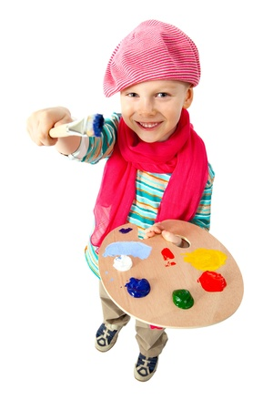 Little artist holds in his hands the palette with paints