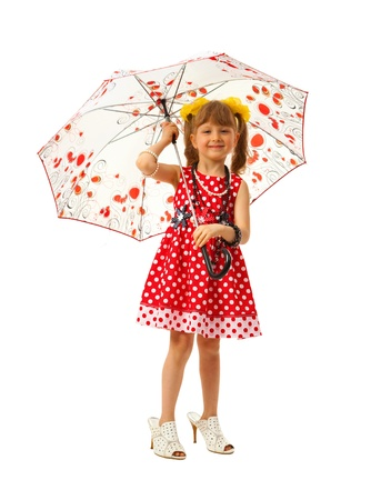 Little girl is fashion-monger with umbrella in adult shoes on white background photo
