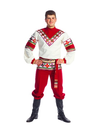folk dancing: Young man dances in national russian dresses on white background.