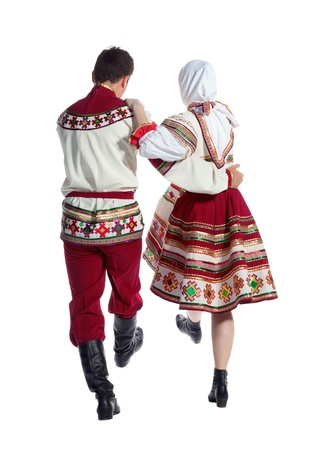 folk dancing: Girl and guy dance in national russian dresses on white background.