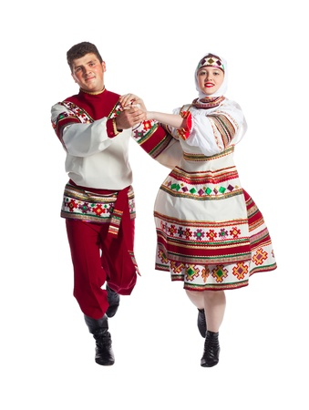 russian man: Girl and guy dance in national russian dresses on white background.