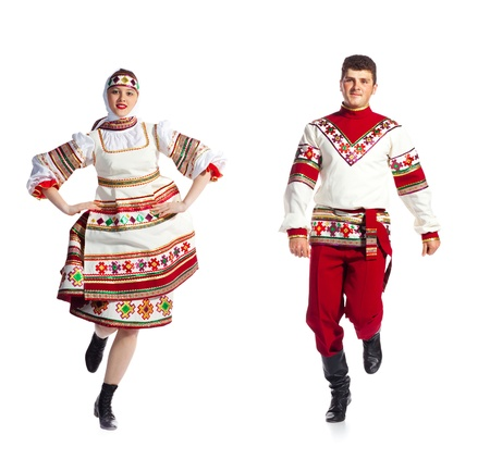 Girl and guy dance in national russian dresses on white background.
