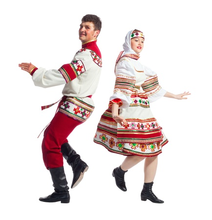 male costume: Girl and guy dance in national russian dresses on white background.