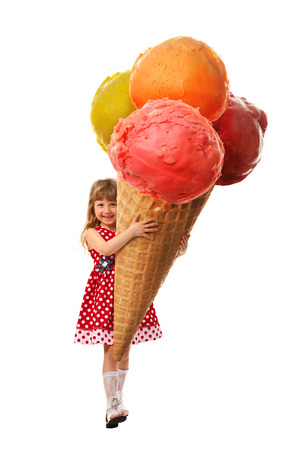Little girl rejoice the very big ice cream which they hold in her hands  On white background  Stock Photo