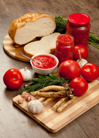 horseradish: Savory tomato, garlic and horseradish and Ingredients for its manufacture  Stock Photo