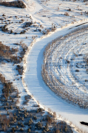 overhand: Aerial view of forest river in winter