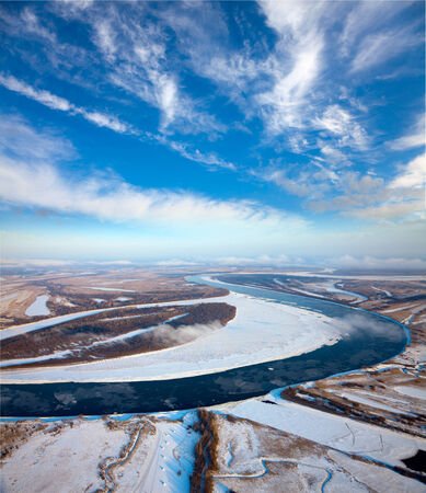 overhand: Aerial view of the great river with floating ice floes during the spring day. Drifting of ice. Driving of ice. Ice floe.