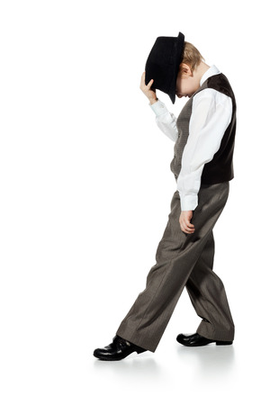 male dancer: Little boy in suit and hat is dansing, isolated on white Stock Photo