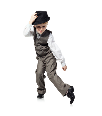 Little boy in suit and hat is dansing, isolated on white Reklamní fotografie