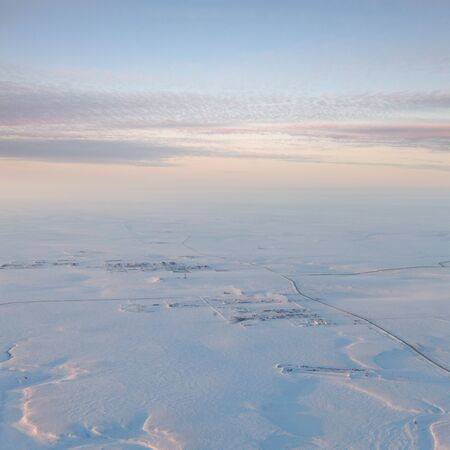 flambeau: Aerial view of endless tundra during a winter day. It is a top view of the oil field, which is located in West Siberia. This rotation village the gas industry.
