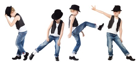 hyperactivity: Little boy in jeance and hat is dancing on white Stock Photo