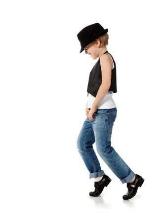 ruffian: Little boy in jeance and hat is dancing on white Stock Photo