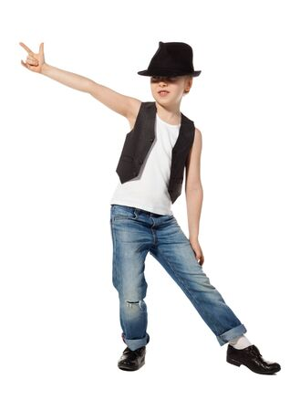 young style: Little boy in jeance and hat is dancing on white Stock Photo
