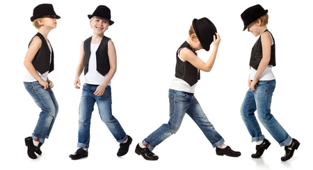 DAnce background: Little boy in jeance and hat is dancing on white Stock Photo