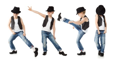 Little boy in jeance and hat is dancing on white Stock Photo