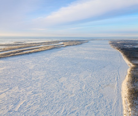 overhand: Aerial view of big north river in time of winter day. Stock Photo