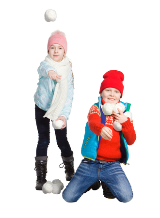 Cildren playing in the snow, isolated on white background. Children in winter. Happy kids playing snowball