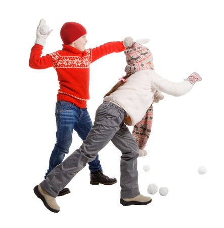 kids playing: Cildren playing in the snow, isolated on white background. Children in winter. Happy kids playing snowball