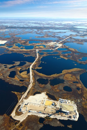 boring rig: Aerial view of oilfield on impassable swamp area. Stock Photo