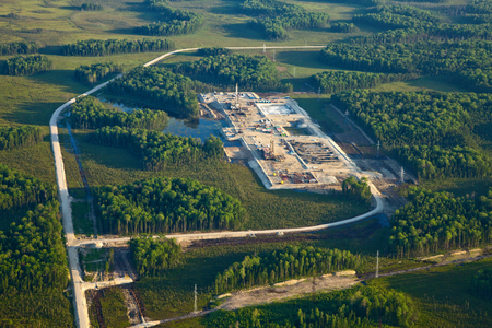 naphtha: Aerial view over oilfield in marshy area in summer. Stock Photo