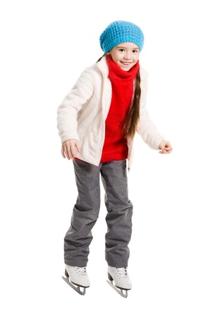 7 9 years: Pretty cheerful little girl doing her first steps in skates on rink, isolated on white