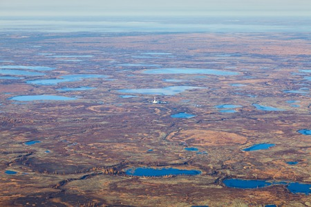 boring rig: Aerial view of oilfield on impassable tundra area.