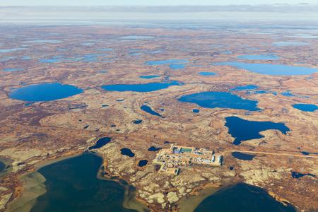Aerial view of oilfield on impassable tundra area.