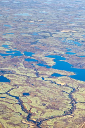 overhand: Aerial view of the tundra in autumn. Blue lakes and reindeer moss. Stock Photo