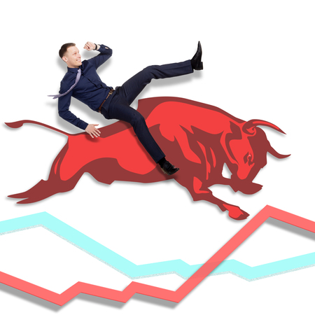 businessman jumping: Businessman is on the jumping red bull on red arrow downward trend line on background of  graphic of  fund. Fight back bullish market concept.