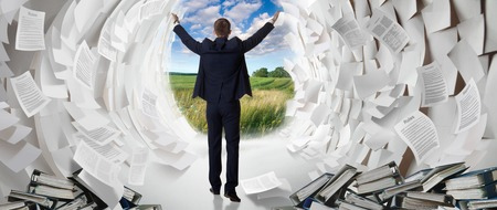 creates: Office worker creates a passage in a paper Sea as Moses. Work hard businessman finds a solution to the problem.