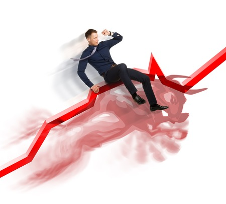 bullish market: Businessman is on the jumping bull on direction red upward trend line on background of  graphic of  fund.  Active sales in bullish market concept.