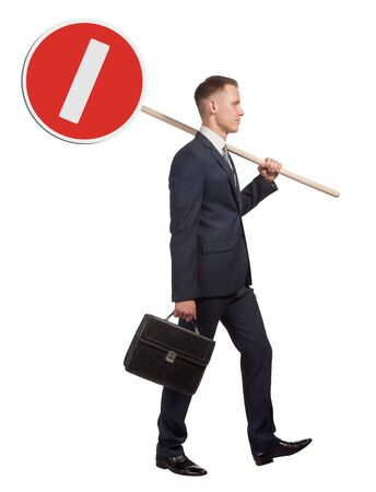 no entry: Official man carries a road sign, which means that no entry. Isolated on white background.