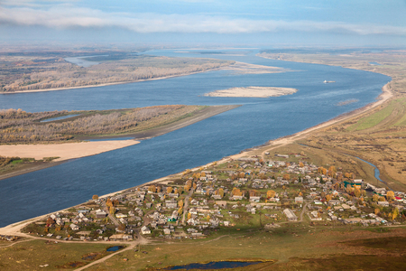 Aerial view the village which is on the coast of the Ob river. Its great siberian river.