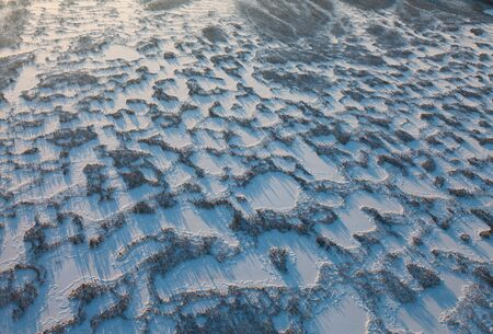 overhand: Aerial view swampy area during frosty winter day. Stock Photo