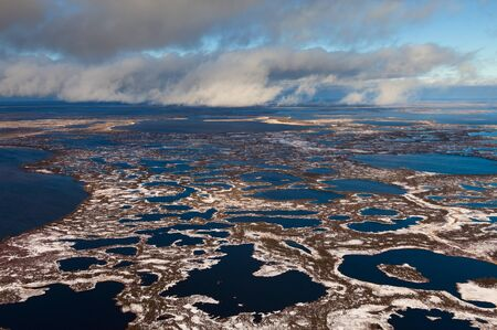 swampy: Swampy tundra were covered by the first snow in start of winter from above Stock Photo