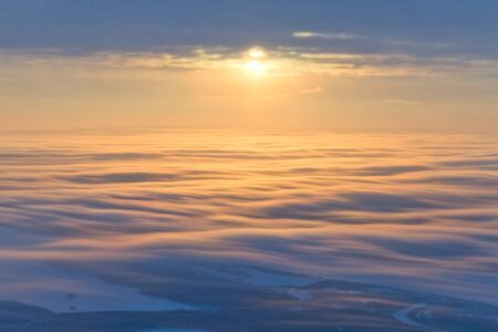 Beautiful sunset over clouds, top view