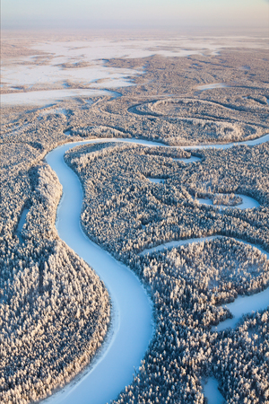 overhand: Aerial view of forest river in time of winter day.