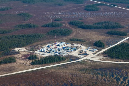 naphtha: Aerial view over oilfield in marshy area in spring.