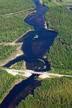 tortuous: View from above Bridge through small river in forest during summer Stock Photo