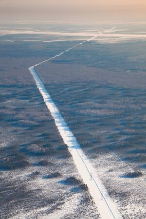 hight tech: Top view of the power line in winter forest