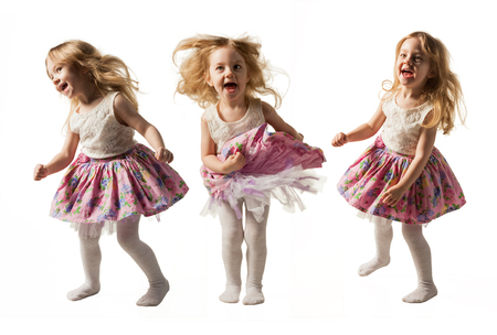 Cute little girl jumping with joy isolated on white background Standard-Bild
