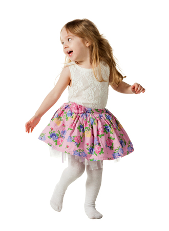 minx: Cute three-year girl jumping with joy isolated on white background