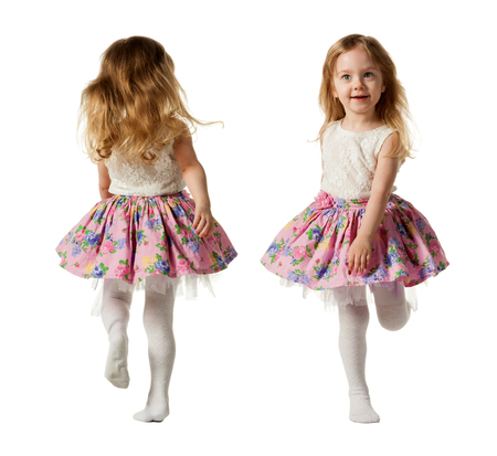Cute three-year girl jumping with joy isolated on white background