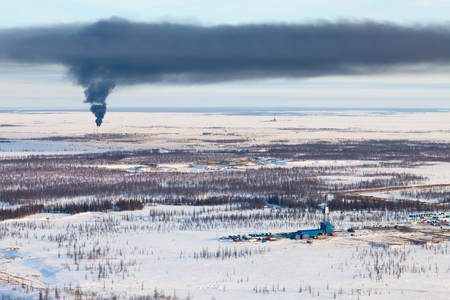 flambeau: Oil field in tundra, view from above Stock Photo