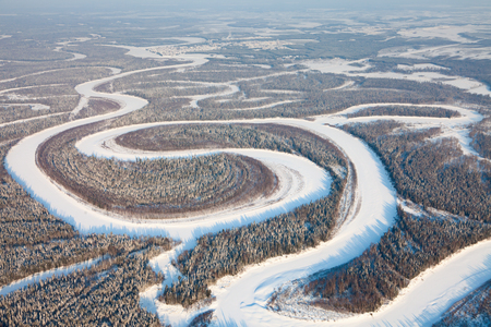 Bird eye view onto forest river in winter