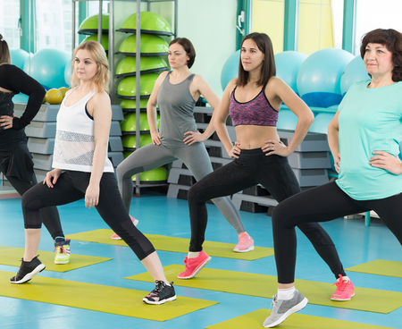 Women doing exercise in the gym Stock Photo