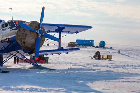 Airplane in winter tundra
