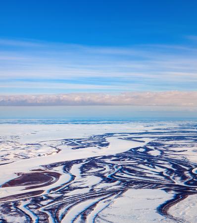 River in winter tundra from above Reklamní fotografie - 100701841