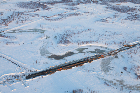 Excavators digging the trench for setting gas pipeline, birds eye view Reklamní fotografie