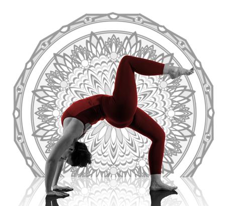 Woman In Urdhva Dhanurasana Yoga Pose on mandala background Reklamní fotografie - 101728695